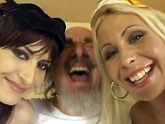 Adrianne Rouso, Monika Unco and Lucy Love are having fun in a backstage video. Lucy strips and boasts of her fantasic boobs and allows some men to touch her jugs.