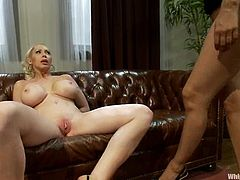 Curvaceous blonde babe gets spanked and whipped by Isis Love. Later on she gets toyed with big dildo and a strap-on.