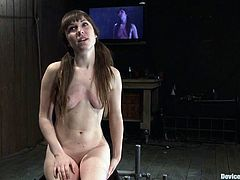 Beautiful dark-haired girl Seda is having fun with some dude in a cellar. She lets the man put her into a pillory and then enjoys getting her twat drilled by a fucking machine.