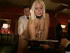 Nice blonde girl sucks a strap on and gets her ass whipped. Later on she gets her pussy drilled with a fucking machine. Surely, then guys her deep and hard.