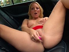 Don't stop looking at this lady, with a shaved pussy and natural breasts, masturbating with a pink dildo in public. She wants you to park right next to her!