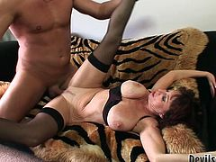 This old woman is as flexible as a gymnast, that's unbelievable. She spreads her legs wide to let her lover to fuck her in missionary position. Horny dude can't decline the offer. He pounds her fanny ruthlessly in and out until she reaches sweet orgasms.