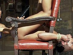 Slim brunette girl lies on a chair being tied up. After that she gives a blowjob to her master. Then Isis Love toys Skin with the strap-on.