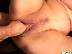 Short-haired mature blonde shows her hairy snatch to some dude and allows him to play with it. Then they bang in side-by-side position on a sofa and the old skank moans insanely with pleasure.