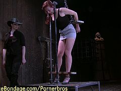This innocent brunette lesbian is involved into her first BDSM play. Her mistress has her all tied up and plays with her like a fucking doll!