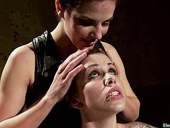 Skinny brunette girl with lots of tattoos gets tied up by Bobbi Starr. Later on she gets her tits tortured with claws. Then she also gets her tits and pussy wired.