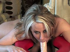 Voluptuous blonde milf Carolyn Reese plays nasty with her new toy cock