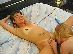 A short-haired slim brunette and her blonde GF are having some good time together. They fondle each other and then favour each other with passionate cunnilingus.