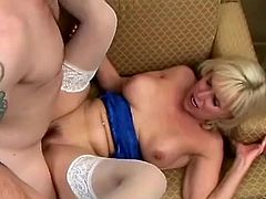 Make sure you see this! A blonde mature woman, with huge knockers wearing sexy blue lingerie and white stockings, while she gets nailed hard!