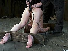 Brunette chick in the stocks her her ass and feet whipped. The she gets her vagina and ass toyed deep by the fucking machine.