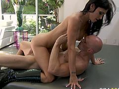 This brunette is aggressive and she knows what she wants. She climbs on top of her lover and rides him passionately in cowgirl position. The way her big tits bounce up and down guarantee his dick won't go limp.