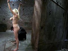 Gorgeous blonde chick gets tied up and gagged by her master. Later on he fixes metal claws to her nipples and toy the pussy with a vibrator.