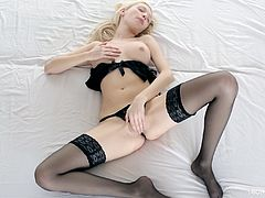 Sexy solo model in black stockings is posing for the camera and fingering her cunt. She looks spectacular and she definitely knows it