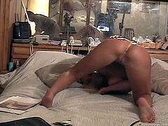 Julie was a little shy at first, but once she was naked and had a dick in her mouth she relaxed and had fun nursing on this guy's love muscle.