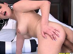 Busty brunette hottie Marisa Mason squats in front of some dude and drives him crazy with a terrific blowjob. Then they fuck in the reverse cowgirl position and Marisa moans loudly.