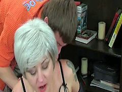 Hot MILF gets fucked at the office. She lies on a desk and lets thuis horny young guy screw her wet pussy roughly and cum on her face