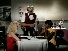 Two lesbians seduce well-endowed waiter and blow his cock in turn