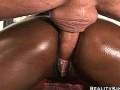 Milan Sterling is a sexy ebony babe with an amazing body. Press play and take a look at her big round ass before as she oils herself up and before being fucked.