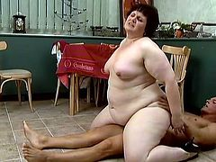 Mature brunette fattie Carol is trying her best to satisfy a handsome young stud. She pleases him with a blowjob and then allows the guy to fuck her plump cunt from behind.