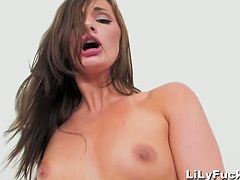 Watch this sexy brunette babe Lily Carter in her short shorts.She sits on her knees for sucking on huge black cock and gets her horny pussy drilled hard by that big black cock.