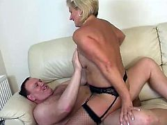 Short-haired blonde mom is having fun with some guy indoors. She lets him eat her juicy cunt and then they fuck in cowgirl and other positions.
