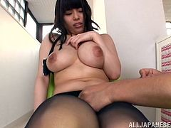 Get a load of Rion Nishikawa's massive natural tits in this hot scene where this guy plays with her and them.