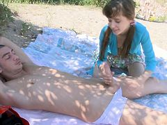 This young couple enjoys a warm day outdoors. The girl starts sucking her bf's cock, then straddles him with her skirt on.
