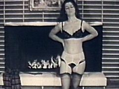 Alluring brunette shows off her hairy pussy and sexy tits in retro cam show