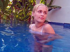 This sexy chick knows that her neighbors watching her while she is in the pool so she is takes off her clothes and do erotic show for them.