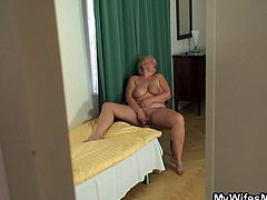 Here I was, stalking my wife's mom. I watched her with pleasure as she plaid with her shaved pussy and felt horny. Because I couldn't help myself, I took out my dick and jerked as I was stalking her. The old broad caught me and she took advantage of the situation and grabbed me by the dick. Watch what we did.