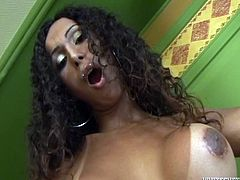 Tall ebony tranny Julia D wearing a bikini is having fun alone. She moves her body sexily and then strips and demonstrates her black dick.