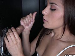 """Wanton brown headed whore sucks medium size bonker through wall. She stands as if she is in karaoke club holding that sweet """"mic"""" and doing her best. Watch this voracious brunette hoe in 21 Sextury sex clip!"""