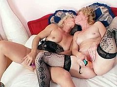 Two insatiable blonde moms are having some good time together. They kiss and fondle each other and then show their pussy-licking and toying skills to each other.