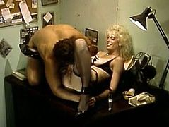 Naughty pale bodied blonde hussy in slutty fishnet stockings and corset takes boss's massive cock up her soaking hairy pussy missionary style.