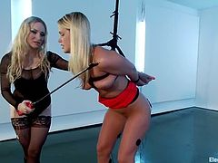 Sexy blonde babe gets tied up and undressed by her hot mistress. Later on Roxy gets stimulated with electricity and it makes her horny.