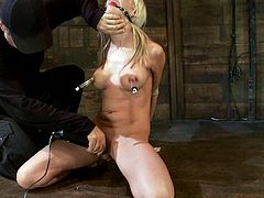 Bound blonde babe gets gagged in some wooden barn. Then she also gets her titties tortured with pumps and claws. Of course she also gets toyed by her master.