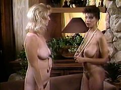 Classy chick Christy Canyon takes part in lesbian threesome