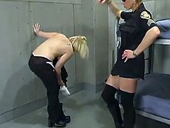 Poor blonde girl gets handcuffed by the policewoman. After that she gets pinched and whipped right in a prison ward. Later on she gets fucked from behind with a strap-on.