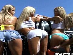 Amazing blonde cutie Franziska Facella and her terrific GFs wearing denim shorts wash a car in the yard and get tired. They go indoors, strips there and then please one another with cunnilingus and fingering.