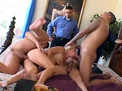 That's how a real gangbang must look like! This delicious and smoking hot blond babe is going to handle three cocks at a time.