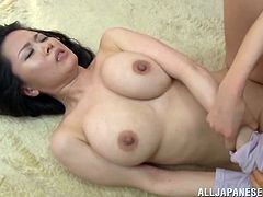 Dude bangs a hottie right there on the floor and her tits and nipples looking gorgeous for the fuckin' camera, check it out!