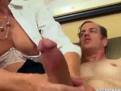 Horny blonde MILF is alone in the office and she is in the kinky mood. She wastes no time and gets her hands immediately on his cock to stroke it like a real pro.
