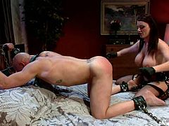 Chad Rock is playing BDSM games with gorgeous brunette dominatrix Sophie Dee indoors. Sophie teases the stud and then pleases him with fisting and destroys his ass with a strapon.