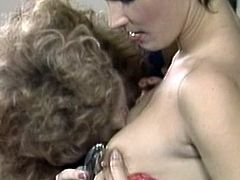 Needy ladies are having a great time masturbating eachother in retro threesome