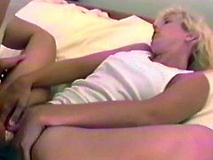 A blonde and a brunette strip their clothes off. Then the blonde girl gets her shaved pussy toyed rough with a strap-on.