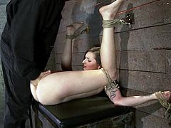 Petite babe with pretty face gets tied up and then toyed with a vibrator by a guy. Then Missy gets her pussy drilled with a strap-on by Isis Love.