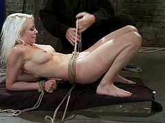 Horny blonde girl gets tied up and tortured with claws fixed to her nipples. Later on she gets her pussy drilled with a strap-on by Isis Love.