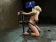 Bosomy blonde Lylith Lavey is getting naughty in a basement. She gets chained and tormented and then rubs her vag against a fucking machine and gets a strong orgasm.