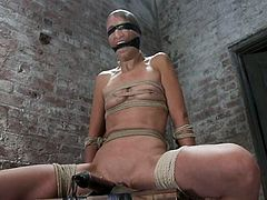 Nice brunette babe gets blindfolded and tied up to the chair. After that she also gets her vagina toyed.