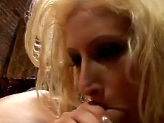 Candy Manson is a blonde bombshell with a dirty mouth! She warms up with a big pink dildo and upgrades to a great big white cock!